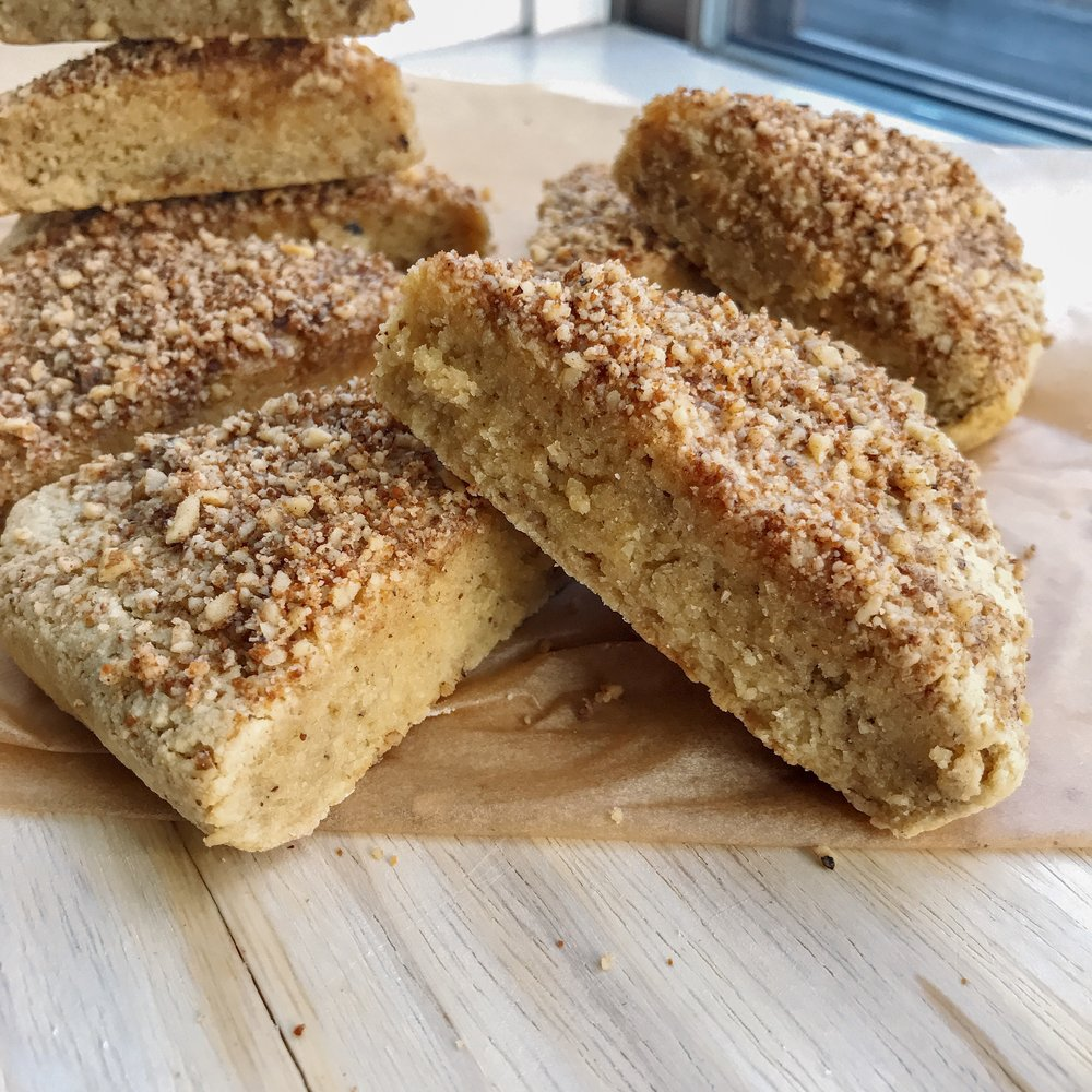 Moist almond flour scones that are lightly sweetened with honey and topped with crushed walnuts, cinnamon, and coconut sugar. 100% dairy free and gluten free.