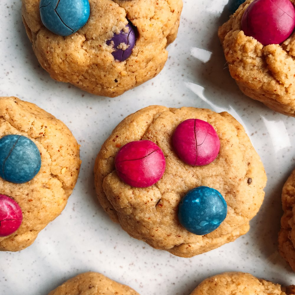 Almond flour M&M cookies that are completely dairy free. Chewy + soft in the middle, with crispy edges!