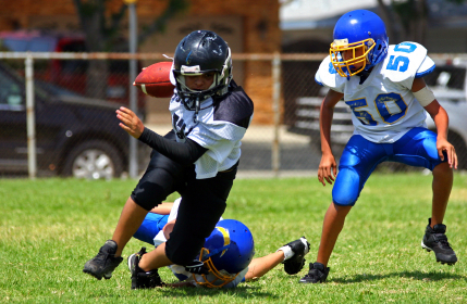 Youth-Football-breaking-tackle.jpg