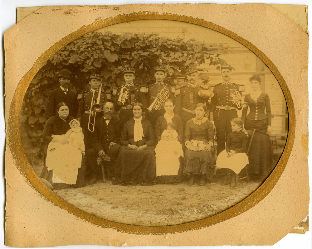 Back of photo has identification of all.