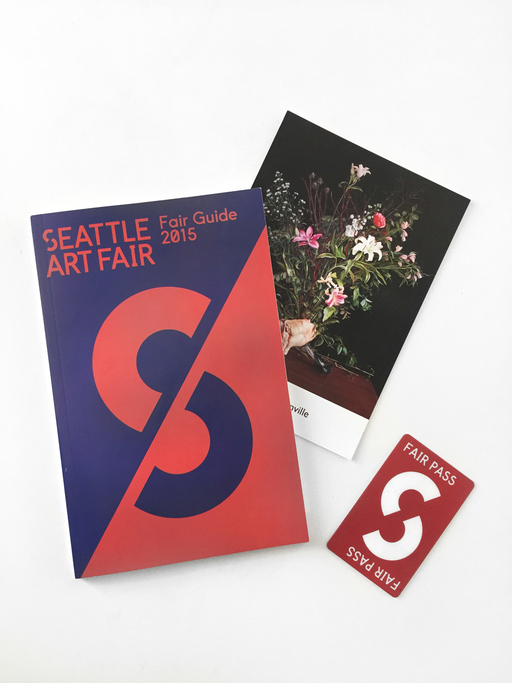 SAF exhibition guide book, gallery postcard, and fair pass. Photo by me.