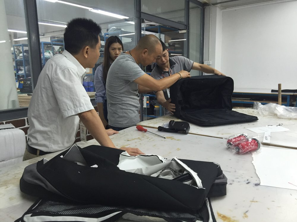 The textile factory team helping out with the final suitcase tweaks
