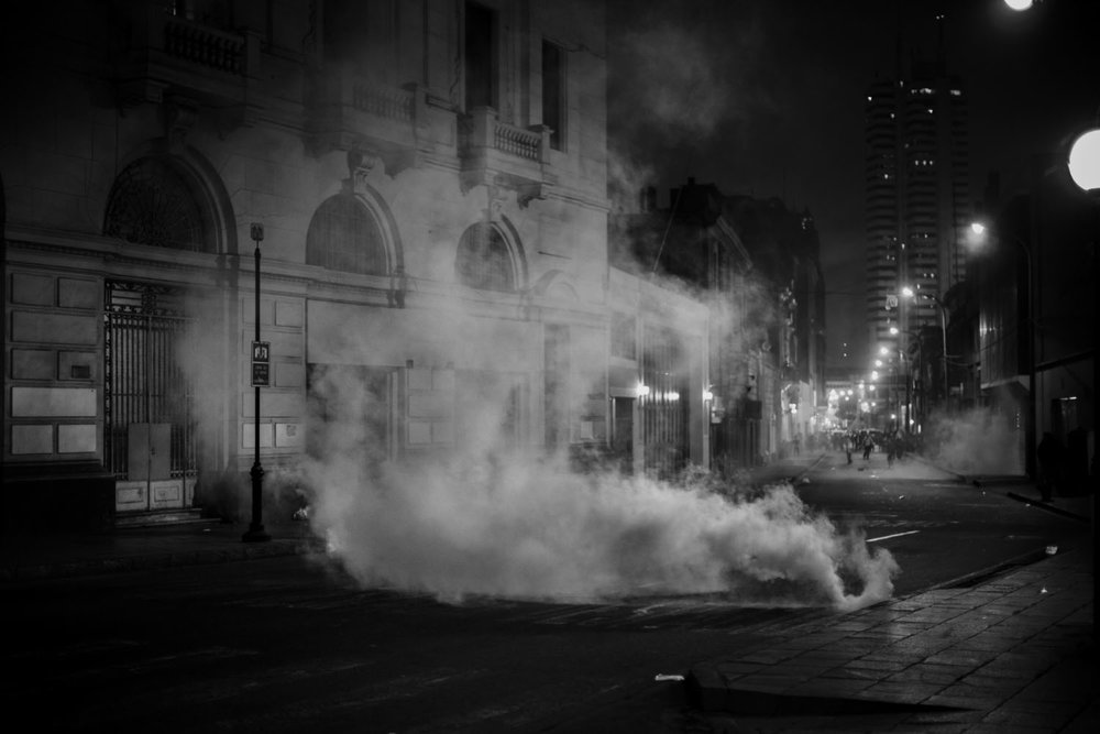 Tear gas on a deserted street after violently dispersing young protesters.