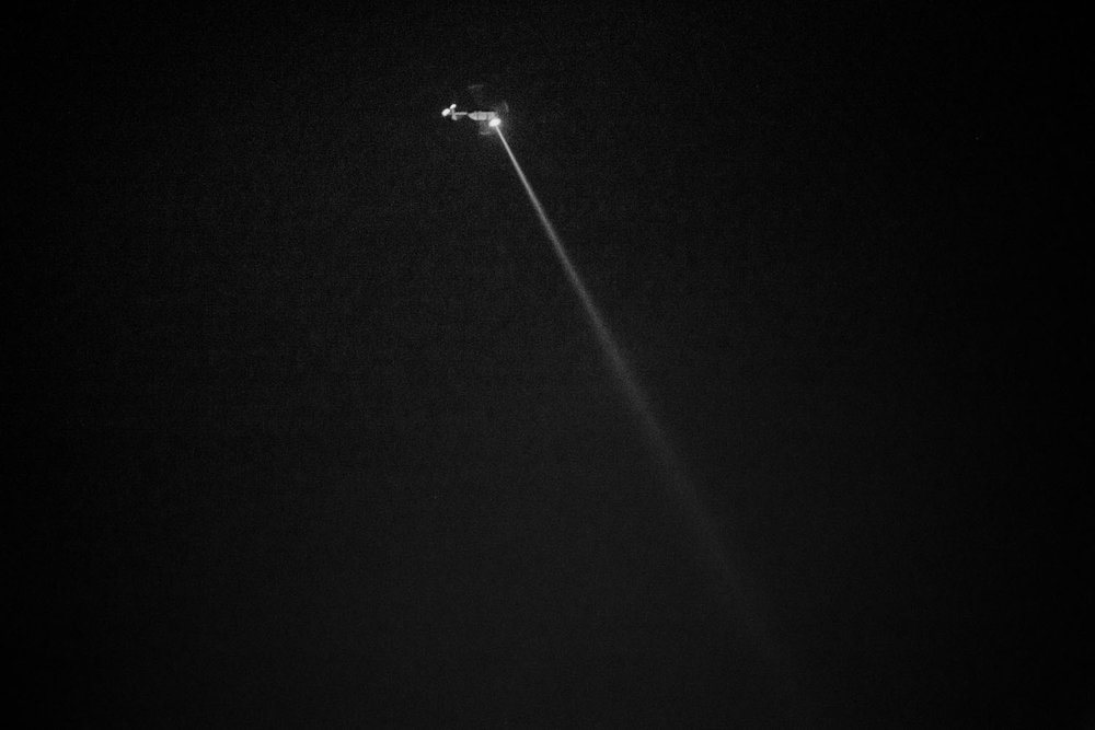 A police helicopter works as surveillance in case situations of violence arise during the marches.