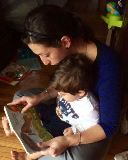 Momma and kiddo enjoy some much beloved reading time with  The Busy Little Squirrel  by Nancy Tafuri.