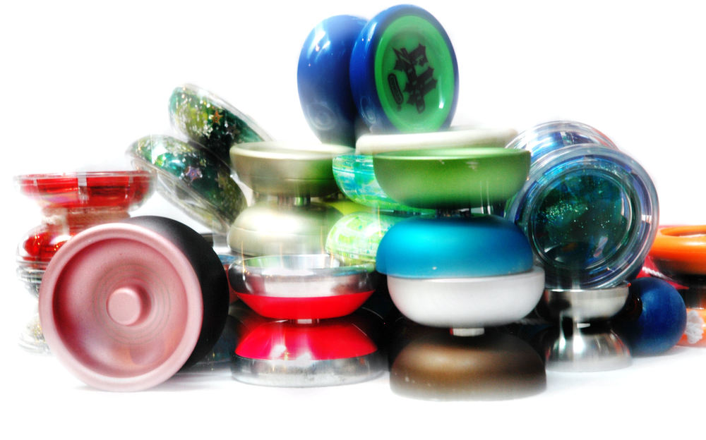 This photo from Flickr showcases yo-yos of various shapes, sizes and colors. (Photo credited to S. J. Pyrotechnic via  https://creativecommons.org/licenses/by-sa/2.0/ .