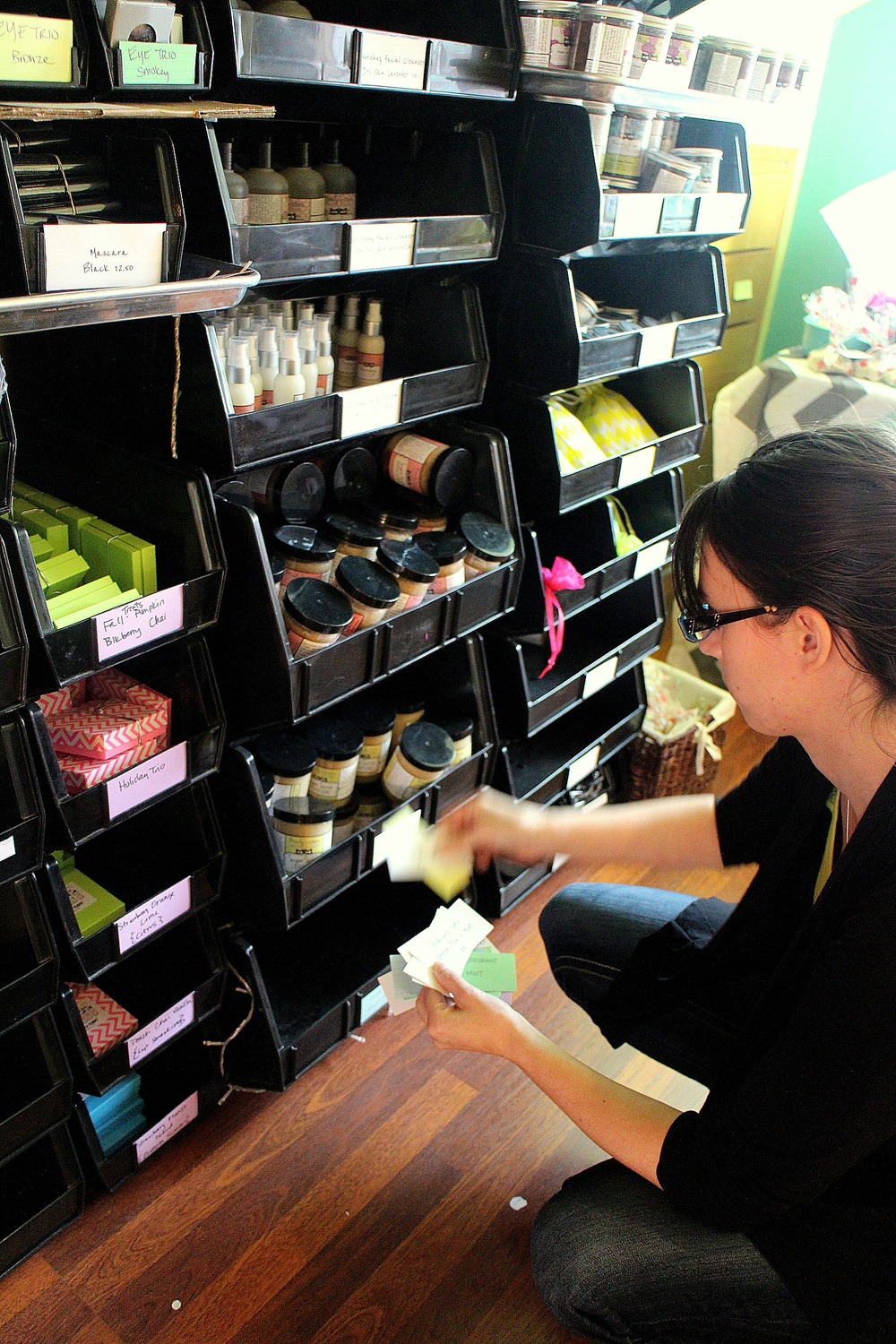 Moody Sister Whitney organizing product and shipping orders.
