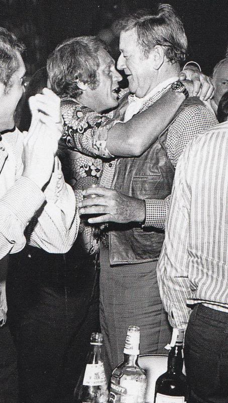 Steve McQueen hugging John Wayne