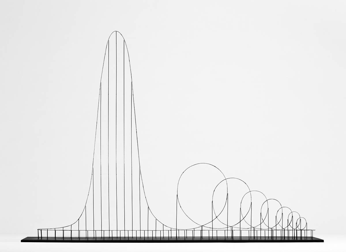 """Euthanasia Coaster""  is a hypothetic roller coaster, engineered to humanely – with elegance and euphoria – take the life of a human being. Riding the coaster's track, the rider is subjected to a series of intensive motion elements that induce various unique experiences: from euphoria to thrill, and from tunnel vision to loss of consciousness, and, eventually, death. Thanks to the marriage of the advanced cross-disciplinary research in airspace medicine, mechanical engineering, material technologies and, of course, gravity, the fatal journey is made pleasing, elegant and meaningful. Celebrating the limits of the human body, this 'kinetic sculpture' is in fact the ultimate roller coaster: John Allen, former president of the famed Philadelphia Toboggan Company, once said that ""the ultimate roller coaster is built when you send out twenty-four people and they all come back dead. This could be done, you know."""