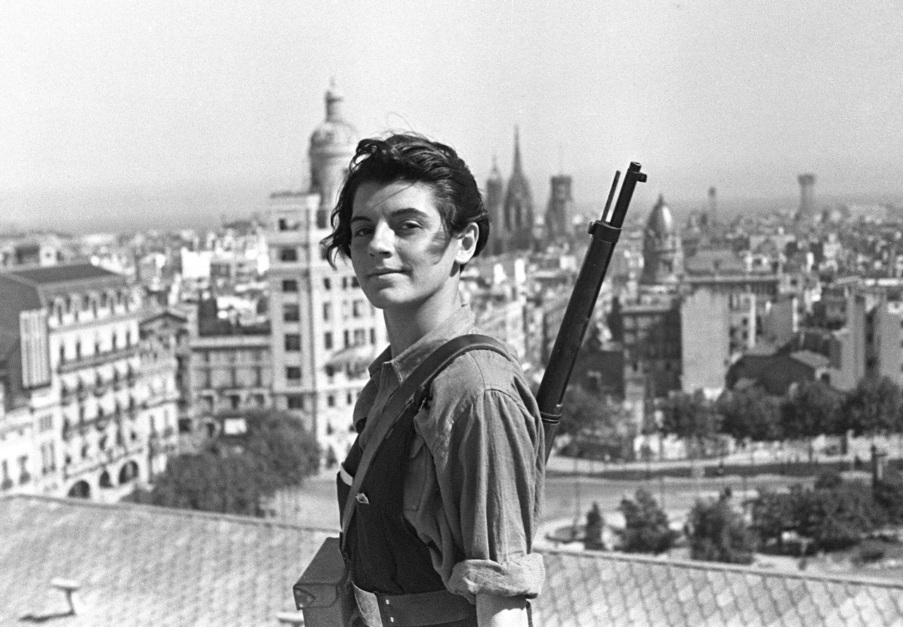 Marina Ginestà   (29 January 1919 – 6 January 2014) was a   French   veteran of the   Spanish Civil War  , who was a member of the   Unified Socialist Youth  . She became famous due to the photo taken by German   Hans Gutmann   (later Juan Guzmán) on the rooftop of   Hotel Colón   in   Barcelona  . It is one of the most iconic photographs of the Spanish Civil War.