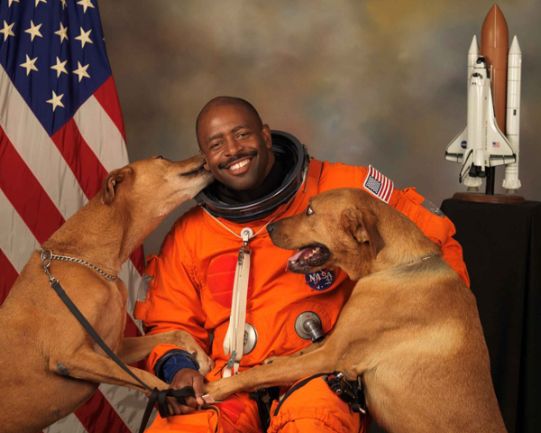 thislandislando :      diamondstodemons :     NASA astronaut Leland D Melvin with his dogs Jake and Scout      Fuck. All. Other. Photos.