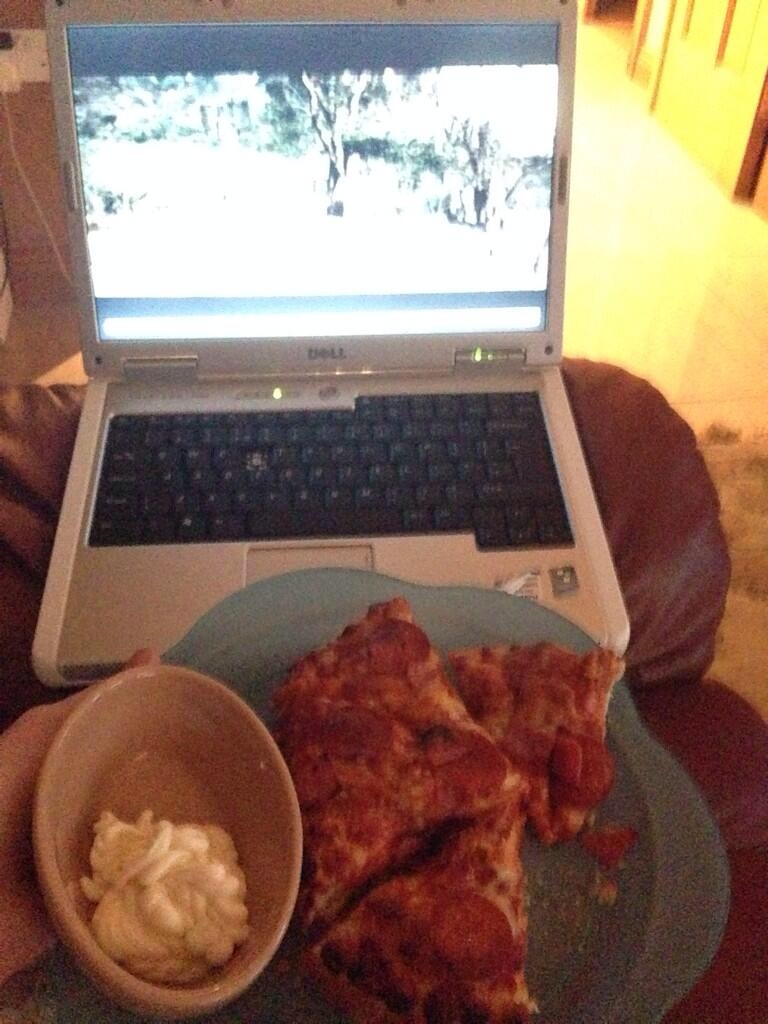 Dipping pizza in mayonnaise. This is apparently a thing people on the Internet do.