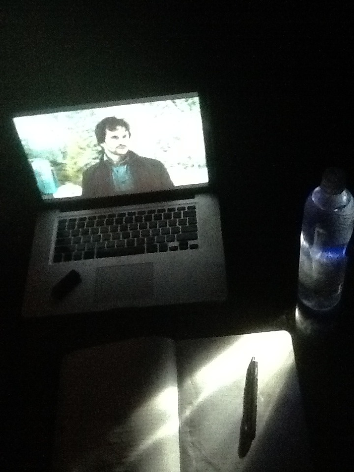late night pitch black improvised workspace (lighting provided by iPhone flashlight shining through a bottle of water)