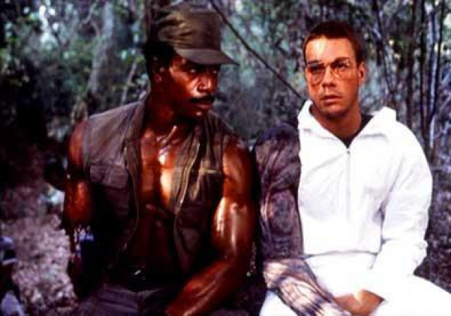 Jean Claude Van Damme on the set of PREDATOR, where he was supposed to play the Predator, before quitting/getting fired. Imagine the world where JCVD was Ray Parks.