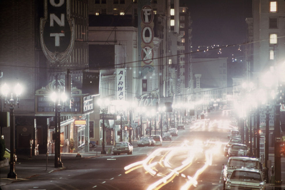 Portland (SW Broadway) in 1973. Limited lighting due to the energy crisis.
