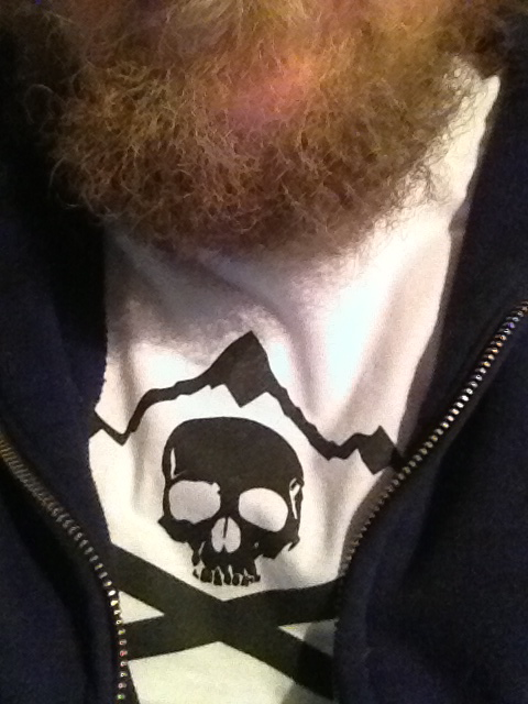 highcrimescomic :     A photo of your writer's beard and shirt.     High Crimes T-Shirts on sale til Friday.       I like them so much I bought two.
