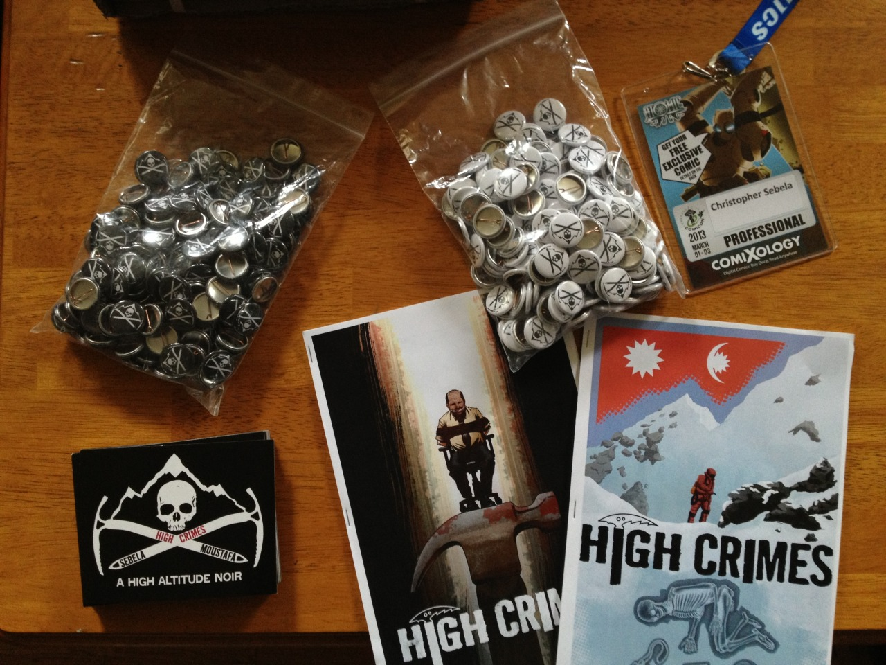 Emerald City Comic Con is upon us and I am soon to enter it with all this in tow for any HIGH CRIMES enthusiasts from today thru Sunday.    Free buttons (in white and black or black and white) and flyers while supplies last. We'll also have a ridiculously limited run of ashcans (not pictured here) and display copies of HIGH CRIMES 1 & 2 (pictured here) on hand.   You can visit Ibrahim at his table: M-05. Or you can track me down wandering the floor. If you want a button/flyer or just to fight me, send me a message on twitter (@xtop) or find me wandering around. I'll be wearing a black hoodie, jeans and a high crimes button where a lapel would be if I dressed like an adult.   Also also, I'll have copies of the SCREAMLAND trade, which I'll be selling for way cheap and a couple issues (7&8) of CAPTAIN MARVEL I'd be happy to sell you for cover price with or without autographs from me and Kelly Sue (if she's not totes swamped at the time).   Otherwise, I am available to be bought drinks and food whenever you feel like it. Come at me bros.