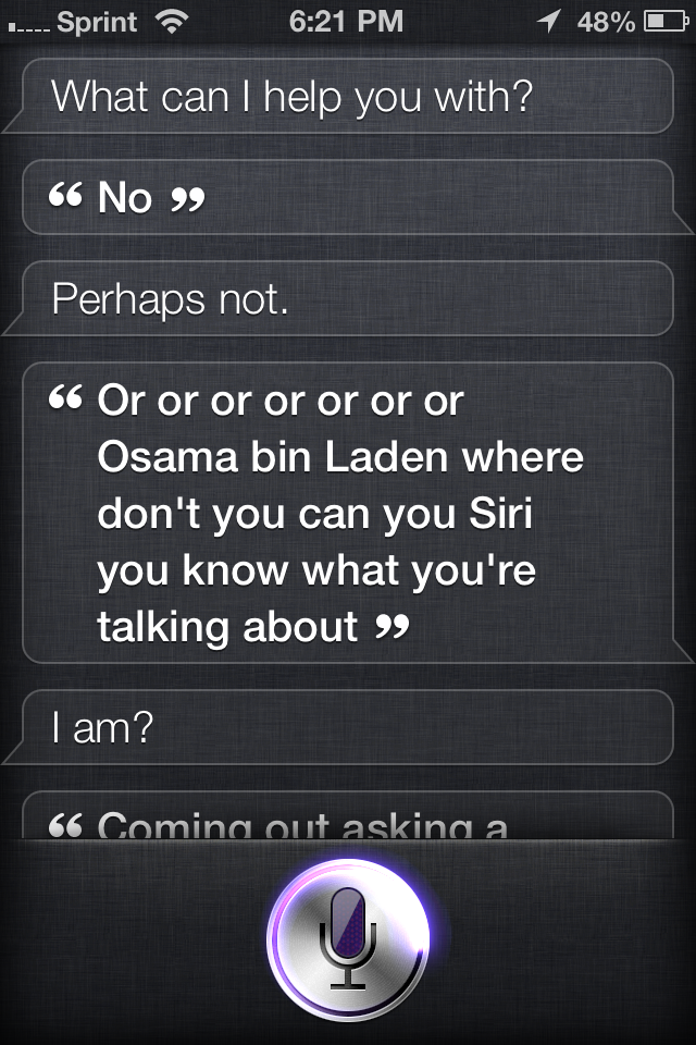 A 2 year old asks Siri a question.