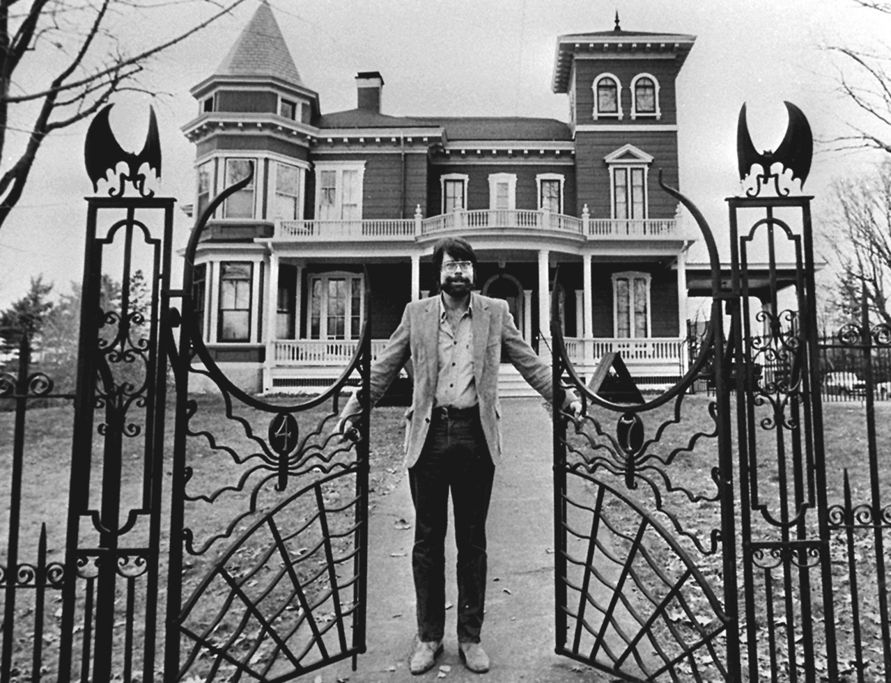 "meta-matter: munstersandghosts: Picture of Stephen King in 1982 outside of his house in Bangor, Maine. ""If you don't want to work your ass off, you have no business trying to write well—settle back into competency and be grateful you have even that much to fall back on. There is a muse, but he's not going to come fluttering down into your writing room and scatter creative fairy-dust all over your typewriter or computer station. He lives in the ground. He's a basement guy. You have to descend to his level, and once you get down there you have to furnish an apartment for him to live in. You have to do all the grunt labor, in other words, while the muse sits and smokes cigars and admires his bowling trophies and pretends to ignore you.""   —-Stephen King, On Writing"