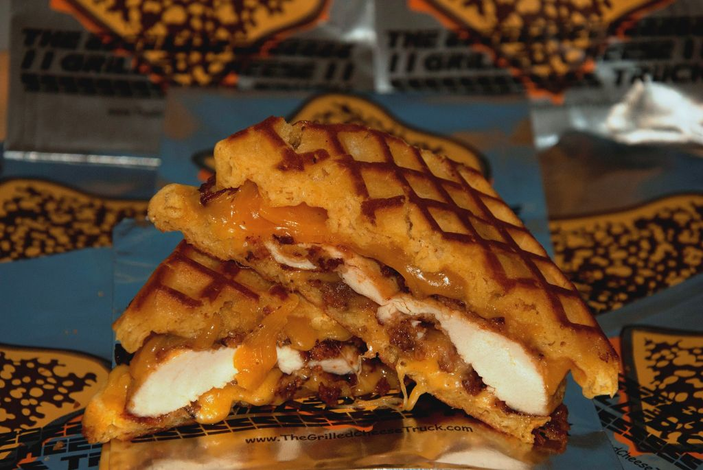 Fried Chicken & Waffle Melt (with bacon maple syrup).   This has been open in my browser for almost a week. I have to put it somewhere so I can stop thinking about it and how this might be the sandwich worth killing for.   Edit: I have not eaten this, it's from LA's Grilled Cheese Truck. But I would crawl over many small babies to get one.