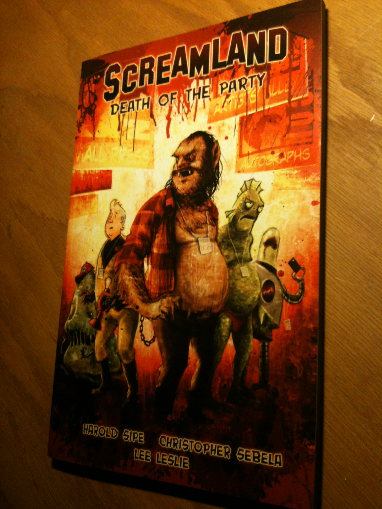 So this came out today. The collected trade paperback of the first five issues of SCREAMLAND, complete with shiny paper stock, a delicious halloween mask smell to it all and a real, true, honest-to-jesus ISBN number that I can assign to the madness that was 2011. It almost feels unreal, but just almost. I put a lot of work into this book, right down to designing the book itself, something I've never done (which will either shock you since you think it's so pretty or makes total sense since you think it's an affront to the global network of design sense) and to have it in my hands, on my desk, on my shelf — alongside books by authors I know and adore — makes everything we went through to make this book happen almost seem completely worth it.  There's indelible memories in here that stretch back to 2008, when we originally conceived of this, so, since I'm completely crap at keeping a journal and gave up blogging (back before giving up blogging was cool), this will have to stand as a roadmap of the last year of my life. I certainly can think of way worse things to mark ones time and I'm grateful that the book will have a whole new life as a volume unto itself.  Oh, I guess I shouldn't forget to shill. You can pick this up at your local comic book shop (and if they're out of them, you can always ask them to order you one) or buy it via online comic shops like Things From Another World or Midtown Comics. Thanks for listening. Today, I love you all. Yes, even you.
