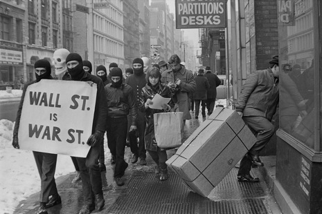 """The next target is Wall Street,"" an anarchist collective known as Black Mask wrote in its January newsletter, 1967. On February 10th, around twenty-five members of the group, wearing black balaclavas and carrying giant skulls, took to the streets of the financial district and handed out this statement:     WALL STREET IS WAR STREET    The traders in stocks and bones shriek for New Frontiers—but the coffins return to the Bronx and Harlem. Bull markets of murder deal in a stock exchange of death. Profits rise to the ticker tape of your dead sons. Poison gas  RAINS  on Vietnam. You cannot plead "" WE DID NOT KNOW ."" Television brings the flaming villages into the safety of your home. You commit genocide in the name of freedom.    BUT YOU TOO ARE THE VICTIMS!    If unemployment rises, you are given work, murderous work. If education is inferior, you are taught to kill. If the blacks get restless, they are sent to die. This is Wall Street's formula for the great society!"