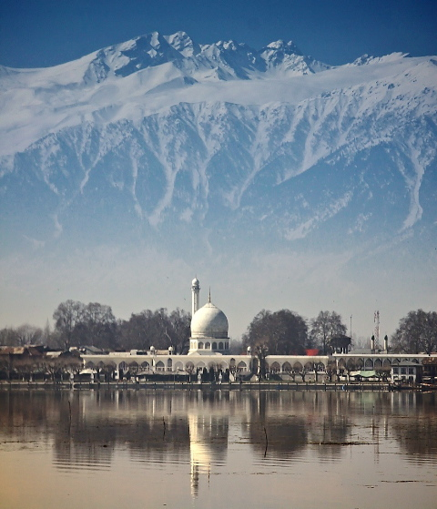 Srinagar, the summer capitol of Indian controlled Kashmir.  This image looks across Dal lake at the mosque and the Pir Panjal mountain range.