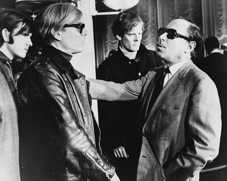 Andy Warhol andTennessee Williamstalking on theSSFrance, 1967.