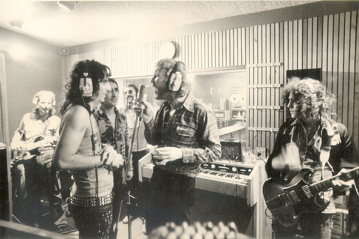 In the studio with Alice Cooper, Keith Moon, Harry Nilsson (mic in one hand, drink in the other) & Marc Bolan, during Cooper's 1973 Billion Dollar Babies sessions. Neither Harry or Moon were credited on the album, so it's possible they just showed up to raid the deli tray.