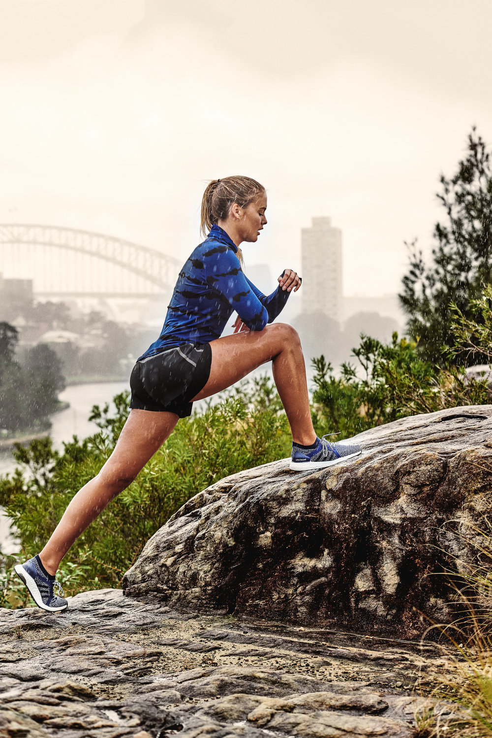 Steph Claire Smith, in the rain for Adidas Australia. Sydney Harbour Bridge in the background.