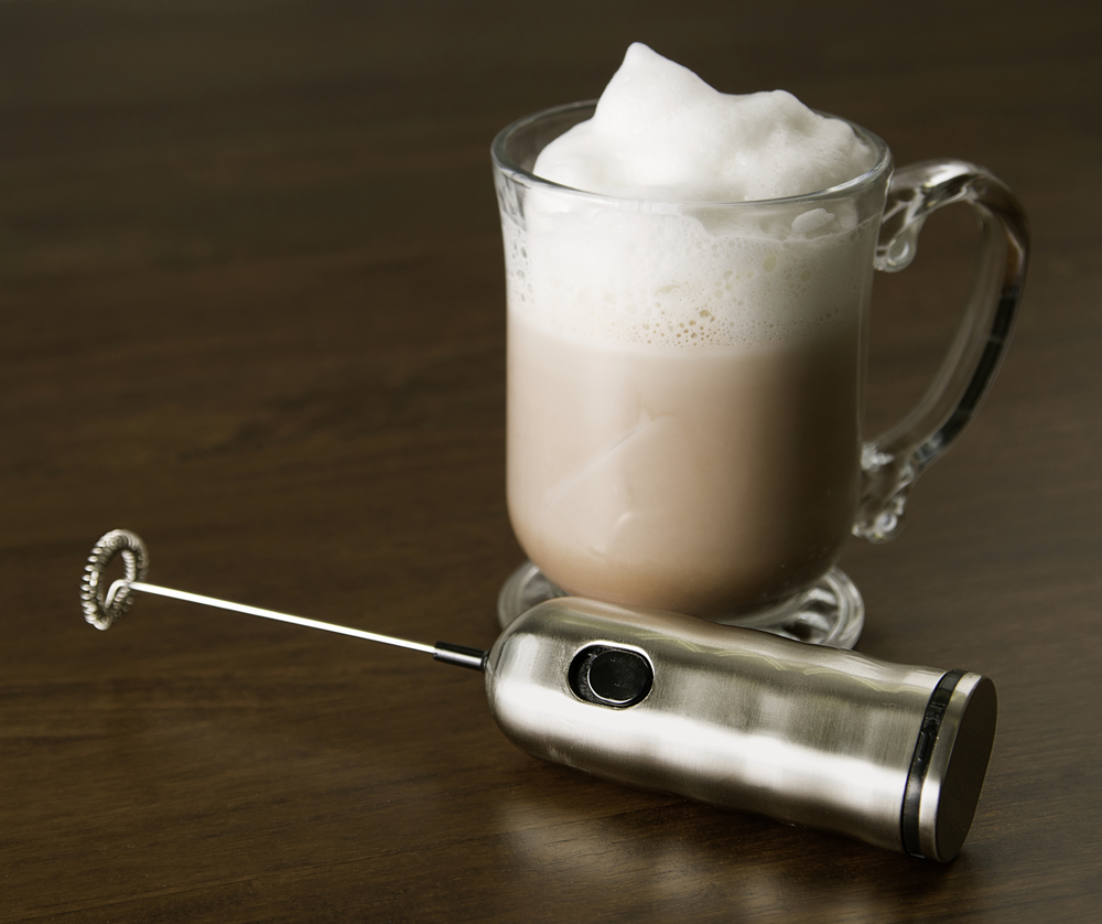 Milk frother with foam latte.jpg