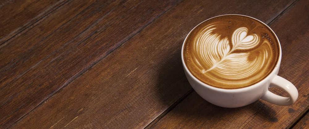 Latte+cup+with+wood+as+background.jpg