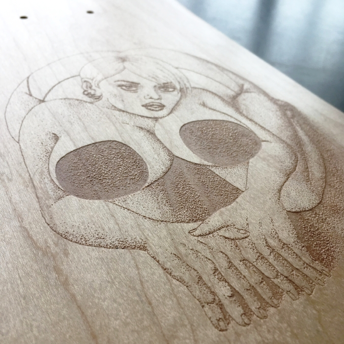 Laser engraved skateboard joelle merizen and le shape