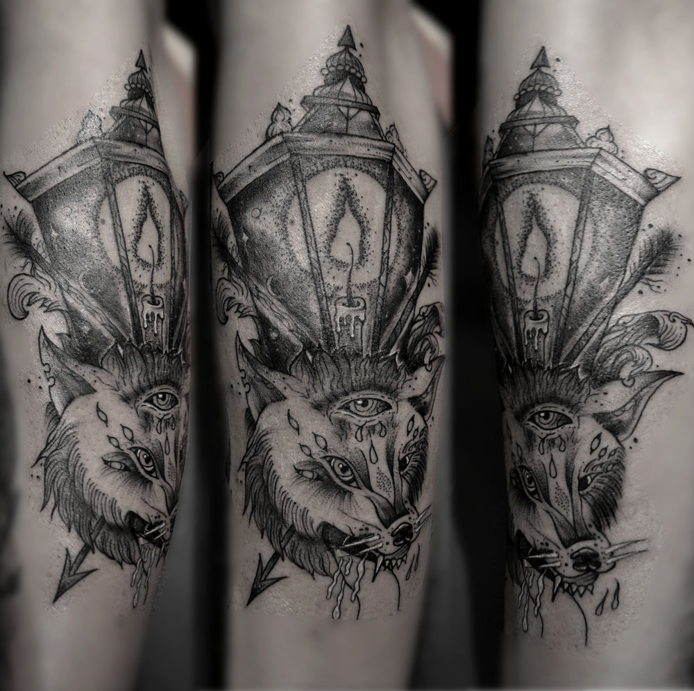 Wolf tattoo by Mike Scythe
