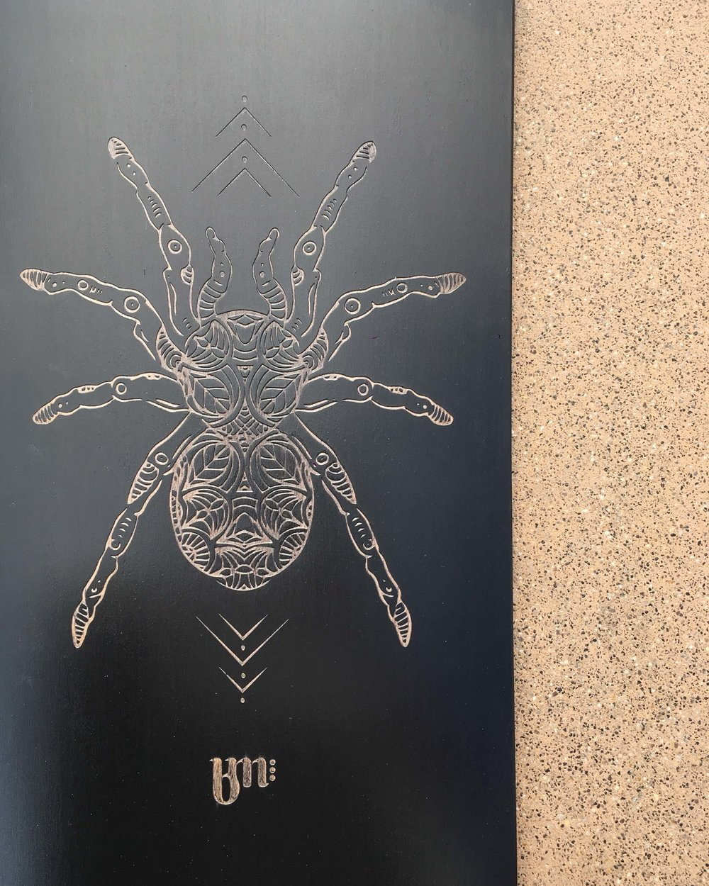 The result of the laser etching on a longboard