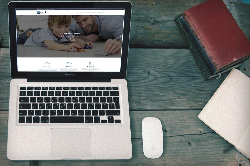 Przygotowanie graficzne wraz z implementacją dla  www.ubezpieczenia-lapka.pl