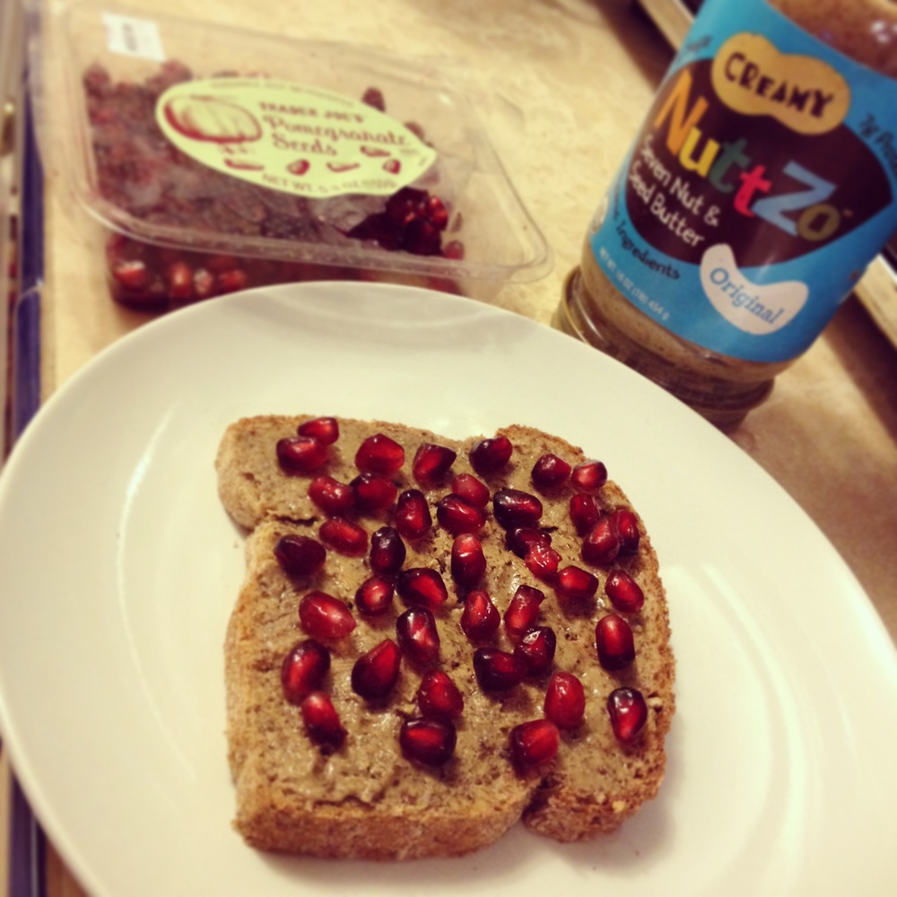 The new and improved PB & J! Ezekiel bread, almond butter (in place of peanut butter), pomegranate seeds (in place of jelly). Delish!