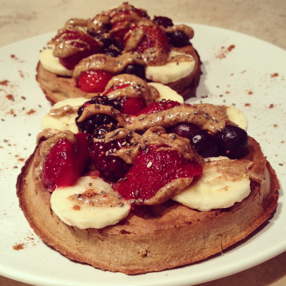 Van's power grains (10g protein/ 2 waffles), fresh berry blend, half banana, drizzle of almond butter, sprinkle of chia seeds and cinnamon.