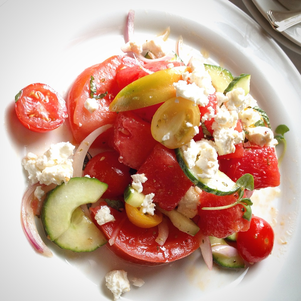 Salad to the stars: cherry tomatoes, cubed watermelon, sliced cucumber, sliced onion, light crumbled feta cheese, faint olive oil drizzle.