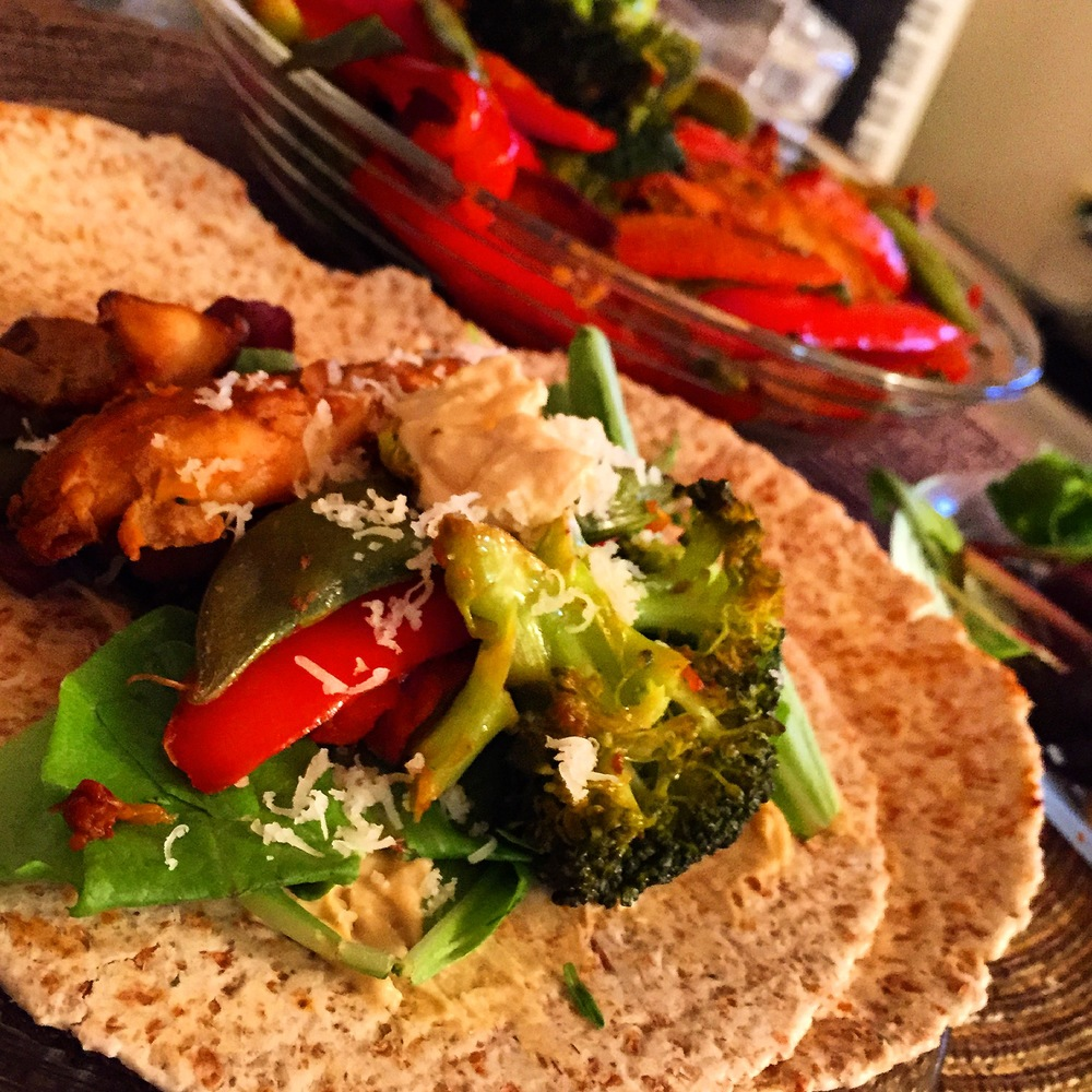 Healthy and lightstir fry with sprouted grain tortillasto fuel up the night before a big workout.