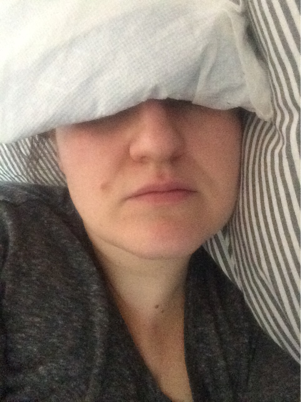 This is how I've spent the last week - ice pack over my forehead/bridge of my nose, lights out and so unhappy.