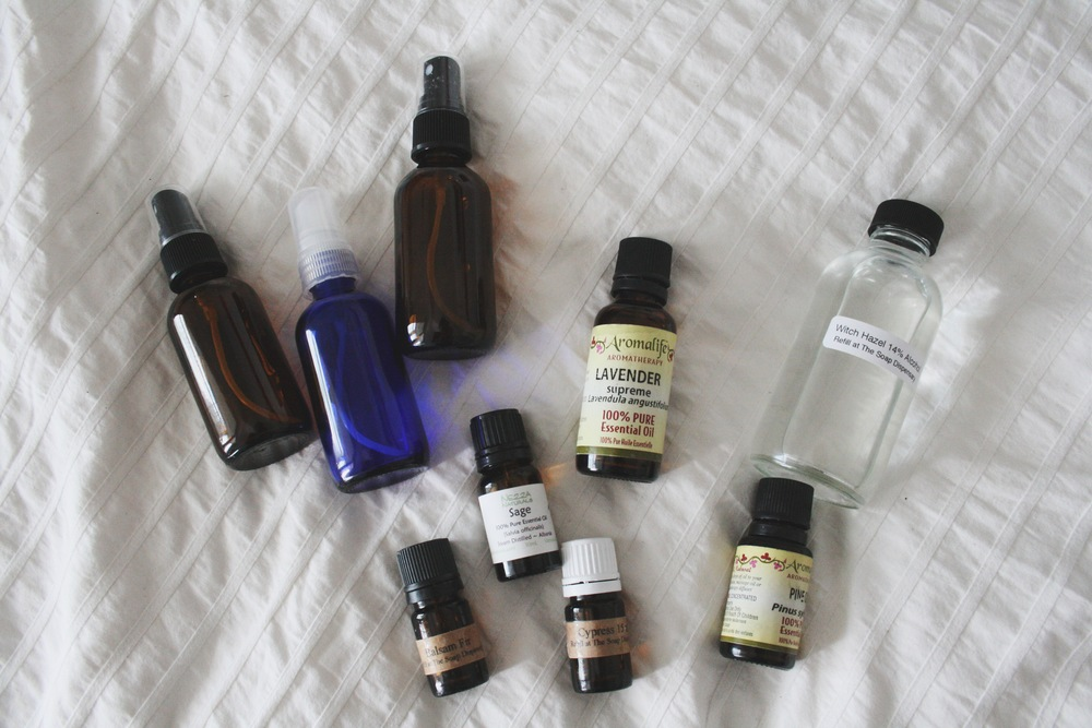 Glass spray bottles, essential oils and witch hazel