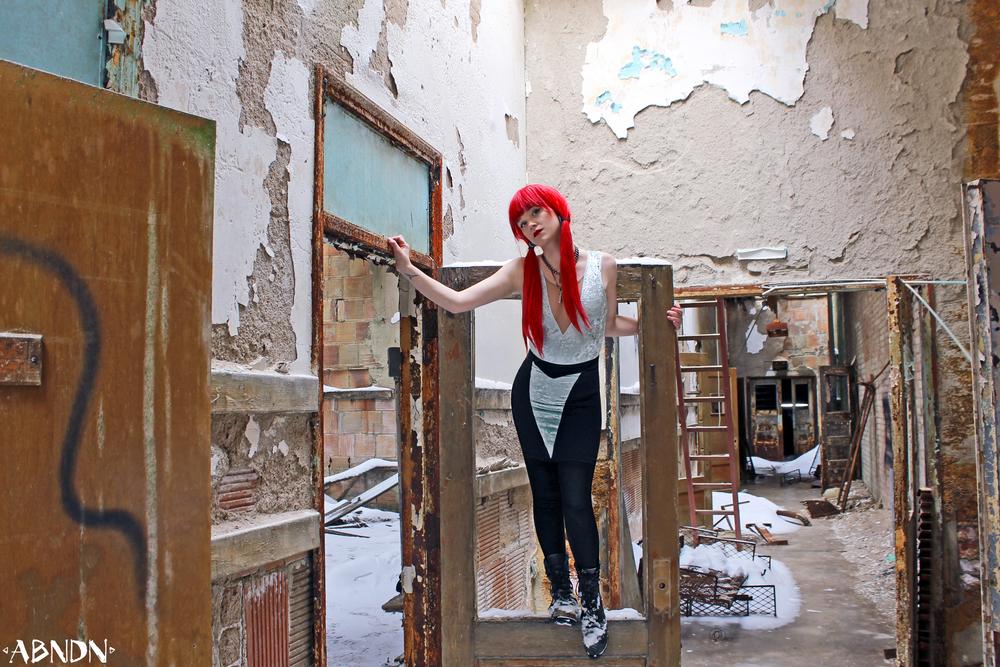 Casey in abandoned hallway