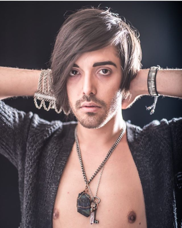 We've always loved this portrait of the beautiful @maxmilianali by @trainingfangs wearing his #labradorite and #fossil #bone #statementnecklace ... these pieces are very old #specimens from collection that is about 100 years old. @abndn.us #theabndnbrand #abndn #malemodel #browsonfleek #stone #mineral