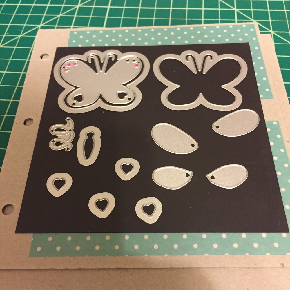 See the magnetic paper is on top of the chipboard and the metal dies are arranged on top.