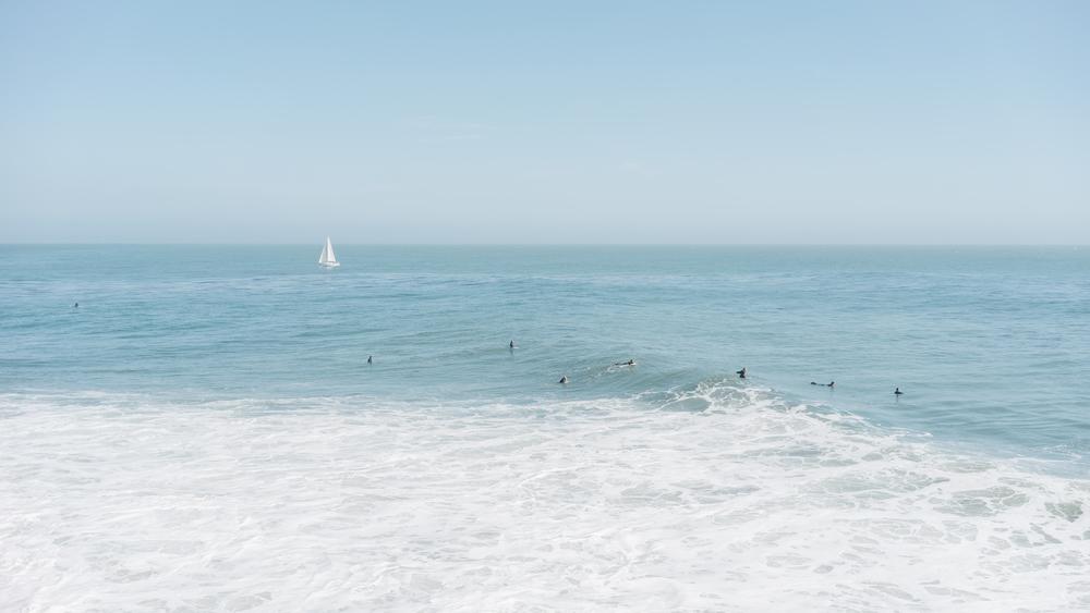 Surfers off the Santa Cruz coast