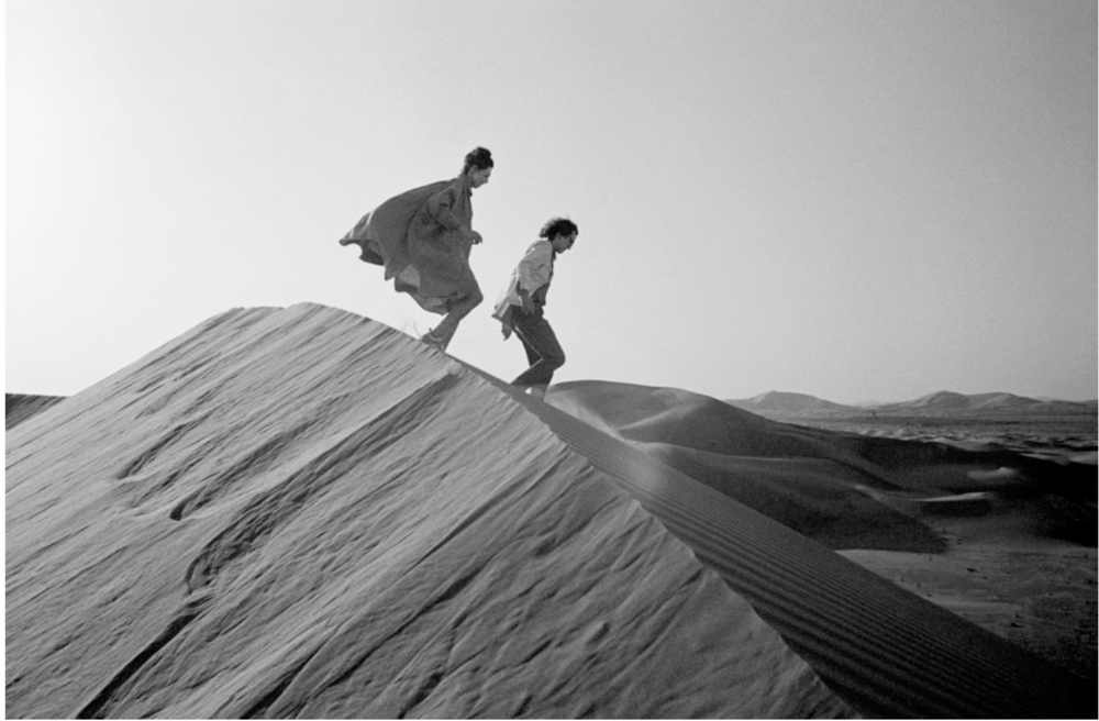 Christo and Jeanne-Claude looking for a possible site for The Mastaba, February 1982 Photo: Wolfgang Volz © 1982 Christo