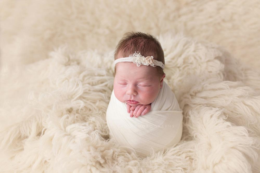 Bailey iowa newborn photographer newborns newborn posing baby girl hull
