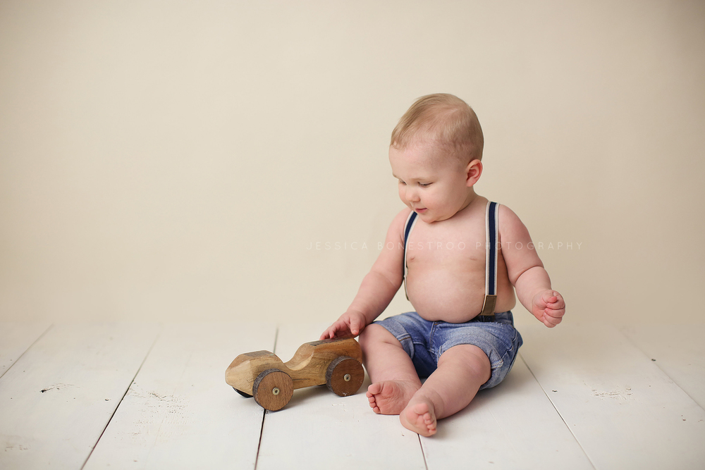 cooper, iowa baby photographer, 1 year old, suspenders, boy, baby's first year, sanborn, iowa, jessica bonestroo photography