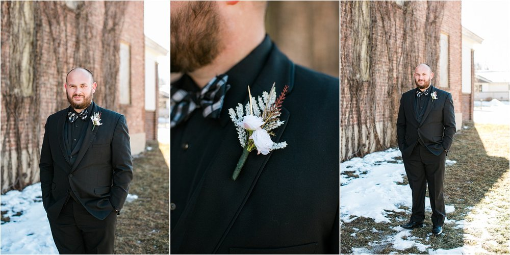 all black groom attire with plaid bowtie